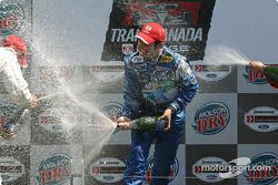 Podium: champagne shower for Memo Rojas