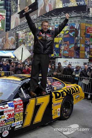 Champion Matt Kenseth stands on his car in Time Square