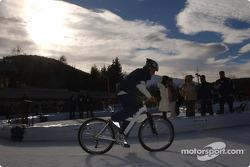 Juan Pablo Montoya rides a bicycle on ice