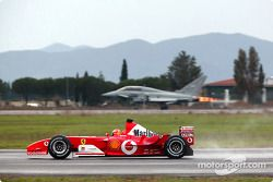 Michael Schumacher ve his Ferrari F2003-GA against Eurofighter Typhoon