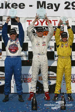 Podium: race winner Ryan Dalziel with Kyle Krisiloff and A.J. Allmendinger