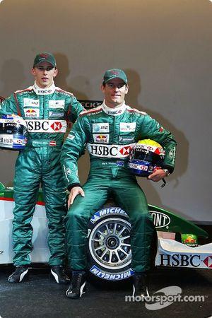 Christian Klien and Mark Webber pose with the new Jaguar R5