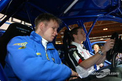 Anthony Davidson and Petter Solberg on Prodrive stand at Autosport International
