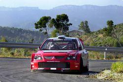 Gilles Panizzi and Gianluigi Galli test the Mitsubishi Lancer WRC04
