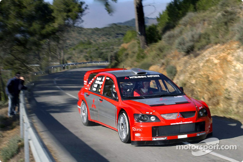 Gilles Panizzi and Gianluigi Galli test the Mitsubishi Lancer WRC04