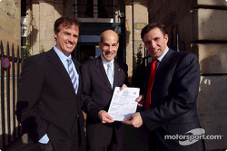 Drivers Danny Sullivan and John Bosch present the first official entry for the Mobil 1 Twelve Hours of Sebring to Scott Atherton, President and CEO of the American Le Mans Series, outside of the Automobile Club of France in Paris