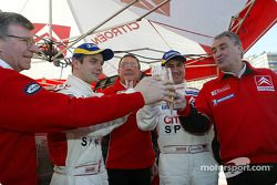 Champagne celebrations for SŽbastien Loeb, Daniel Elena, Guy FrŽquelin and Citro'n Sport team me