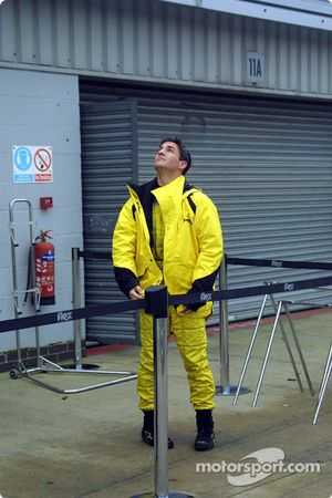 Timo Glock checks out weather
