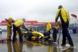 Timo Glock does a pit stop