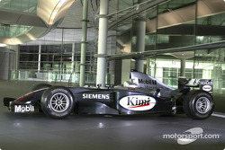 Team McLaren Mercedes Formula One car in front of the Schüco manufactured facade at the McLaren Tech
