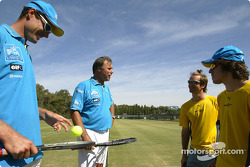 Jarno Trulli and Fernando Alonso play tennis with ex and current tennis players, John Alexander and John Fitzgerald