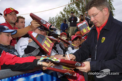 Ross Brawn signs autographs