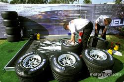 Toyota team members prepare the tires