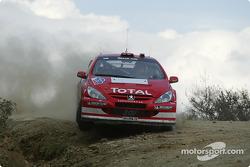 Marcus Gronholm y Timo Rautiainen
