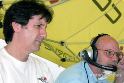 Ron Fellows watches computer data before taking his turn behind the wheel of the Corvette Racing C5-R