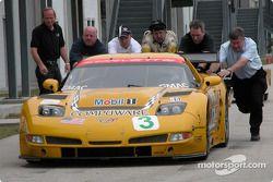 Members of the Corvette Racing push the #3 Chevrolet Corvette C5-R in the Sebring paddock