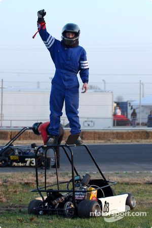 Double winner #48-Matthew Ferris celebrates a win on top of his champ kart