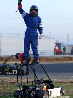 Double winner #48-Matthew Ferris celebrates a win on top of his champ kart