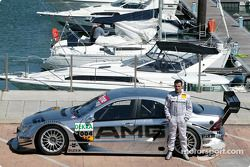 Jean Alesi poses with the AMG-Mercedes C-Class DTM