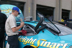 Crew member works on Matt Kenseth's Busch car