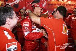 Michael Schumacher celebrates pole position with Rubens Barrichello and Jean Todt