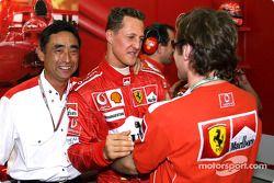 Michael Schumacher celebrates pole position with Luca Badoer