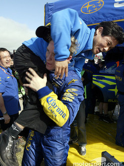 Petter Solberg celebrates victory with Subaru president Katsurada
