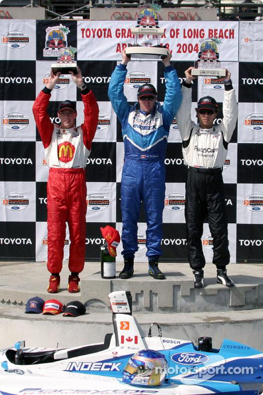 Podium : Le vainqueur Paul Tracy, avec Bruno Junqueira et Sébastien Bourdais