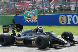 Gerhard Berger drives Ayrton Senna's Lotus around the Imola circuit as a tribute to his lost friend