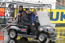 Tony Schumacher, Gary Scelzi and Whit Bazemore head back to the shelter of the haulers
