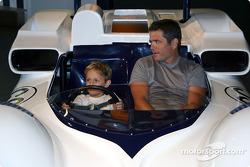 Gil de Ferran and son sitting in 2E mock-up
