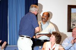 GM's Ed Welburn presents an award to Jim Hall