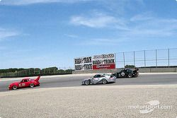 Group of Porsche Club of America Porsches battling for position at the top of the Corkscrew