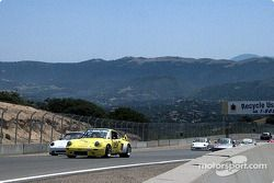 Group of Porsches from PCA cresting the hill before the Corkscrew