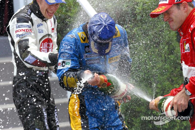 Podio: champagne para Jarno Trulli, Jenson Button y Rubens Barrichello