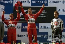 Podium: race winner Michael Schumacher with Rubens Barrichello and Jenson Button