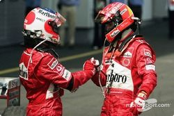 Race winner Michael Schumacher celebrates with Rubens Barrichello