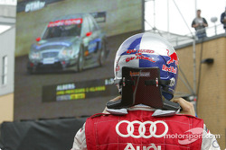 Mattias Ekström watches Christijan Albers on the giant screen