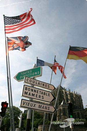 Traffic signs and flags in downtown Le Mans