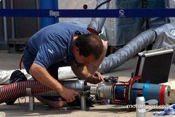 Sauber team member checks refuel material