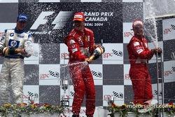 Podium: champagnefor race winner Michael Schumacher, Ralf Schumacher and Rubens Barrichello