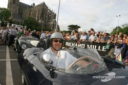 Exotic cars parade: a proud Jaguar owner