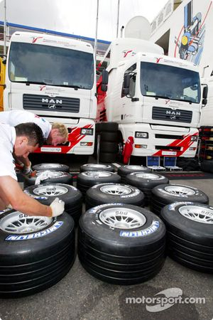 Toyota team member prepares the Michelin tires