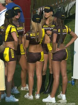 The Pirelli girls wait for the podium ceremony