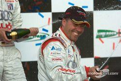P1 podium: champagne for JJ Lehto