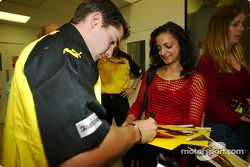 Timo Glock signs autographs for Sport Relief