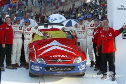 Podium: winners Carlos Sainz and Marc Marti celebrate with Sébastien Loeb, Daniel Elena and Corrado