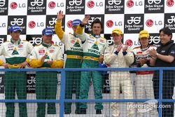 Podium N-GT : les vainqueurs Emmanuel Collard et Stéphane Ortelli, avec Sascha Maassen et Lucas Luhr