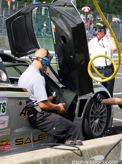 The ACEMCO crew makes adjustments to their Saleen S7R during morning warm-up