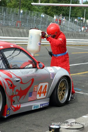 A Flying Lizard Motorsports crew member refuels their #44 Porsche GT3 RSR